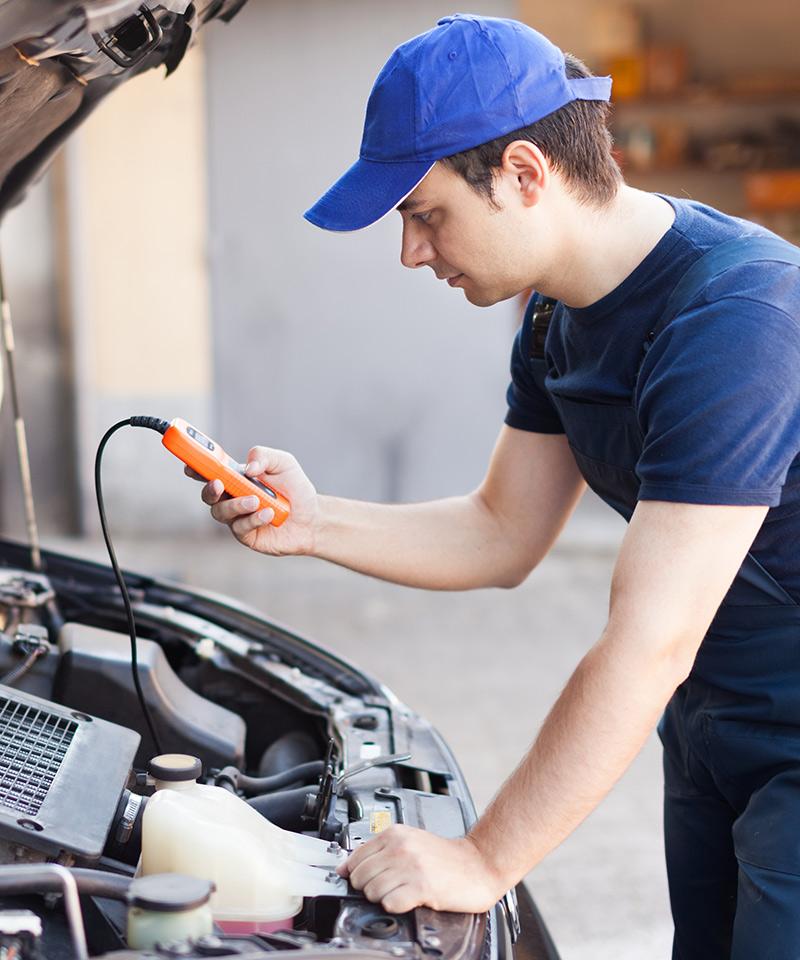 Mechanic diagnosing a vehicle - Car Diagnostics Greenwich