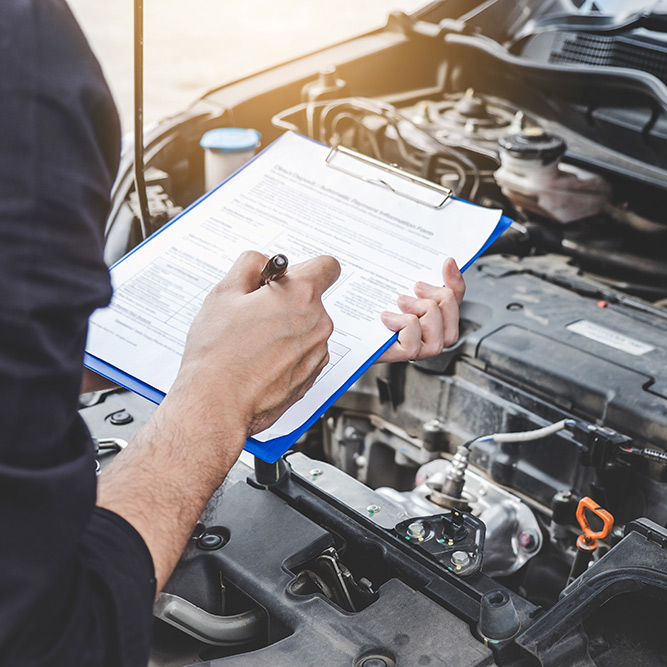 Mechanic checking and servicing a vehicle - Car Service Greenwich