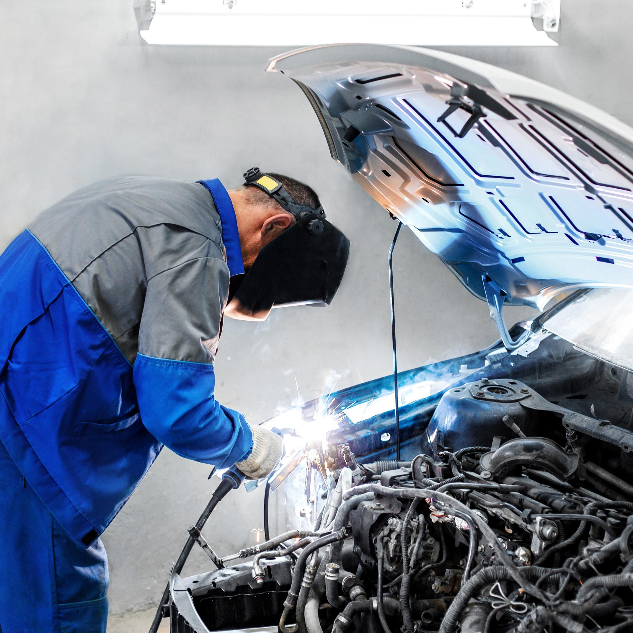 Mechanic repairing a vehicle - Car Repairs Greenwich